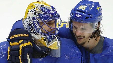 Sweden goaltender Henrik Lundqvist, left, is congratulated by