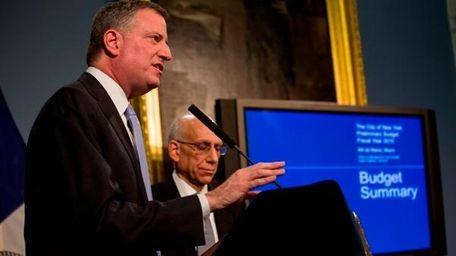 New York Mayor Bill de Blasio, left, standing