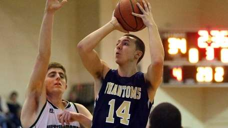 Bayport-Blue Point Doug Niblock drives the lane with