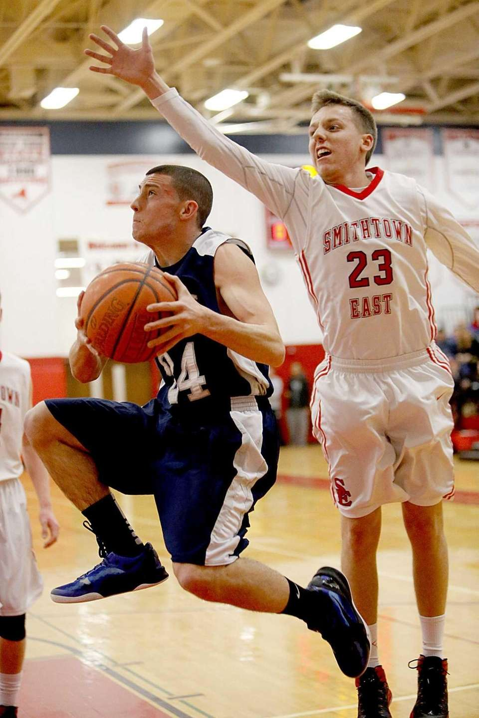 Eastport-South Manor's Mike Cestare drives along the baseline