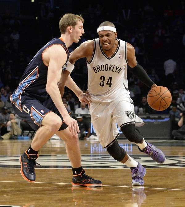 Nets forward Paul Pierce drives past Charlotte Bobcats