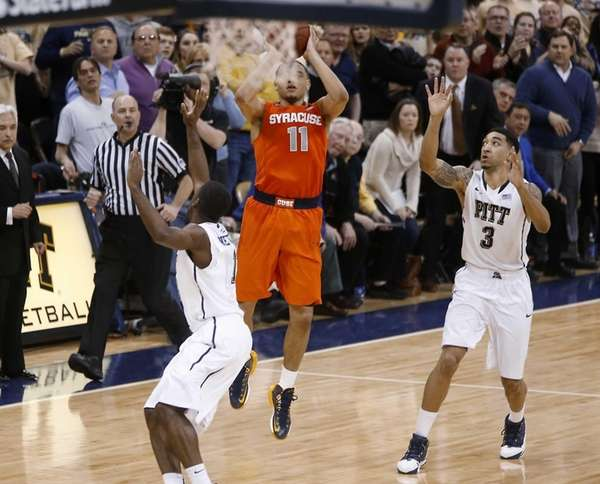 Syracuse's Tyler Ennis shoots the game-winning three-pointer between