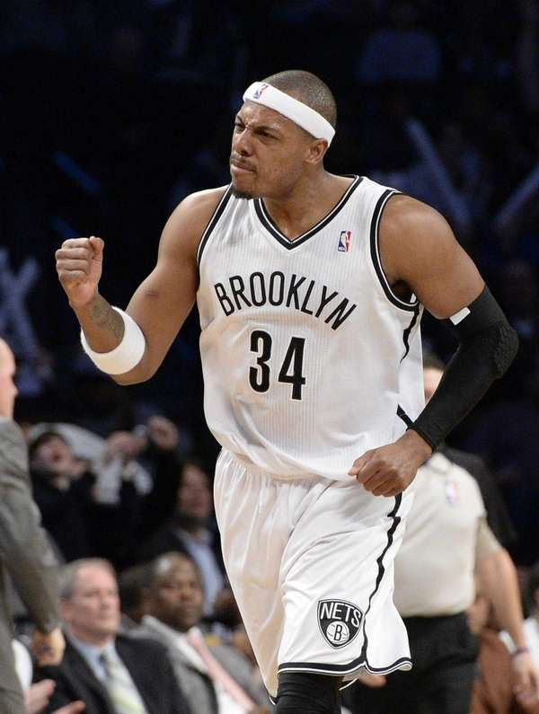 Nets forward Paul Pierce reacts after scoring a
