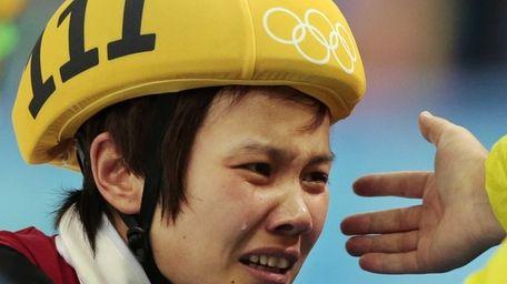 Li Jianrou of China cries after winning the