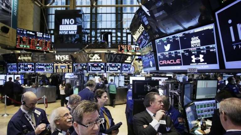 Traders monitor stock prices at the New York