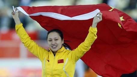 Gold medallist China's Zhang Hong holds her national