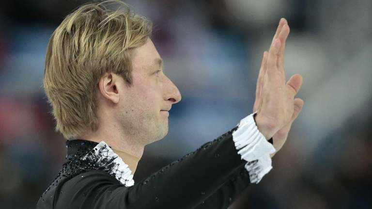 Evgeni Plushenko of Russia waves to spectators after