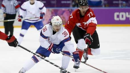 Norway forward Mats Zuccarello takes the puck up