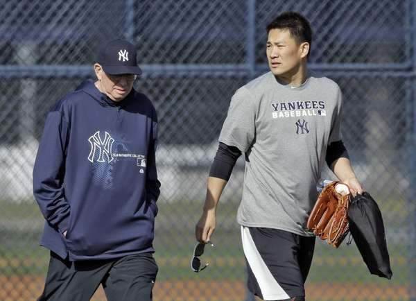 Yankees pitcher Masahiro Tanaka, right, walks with pitching