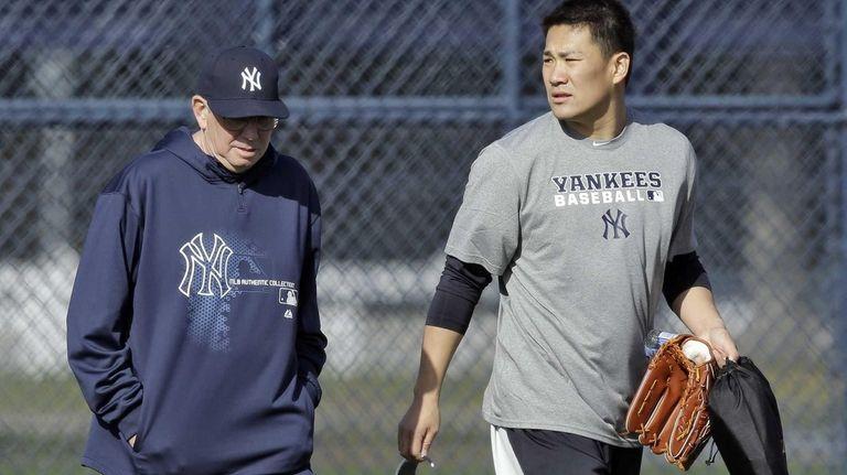 Yankees pitcher Masahiro Tanaka, right, walks with pitching