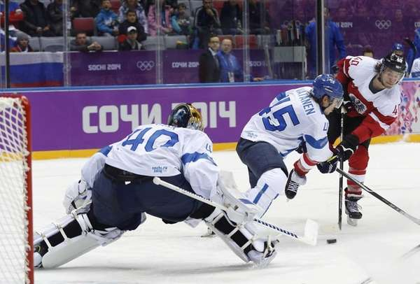 Austria forward Michael Grabner shoots to score against