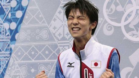 Yuzuru Hanyu of Japan reacts as he receives