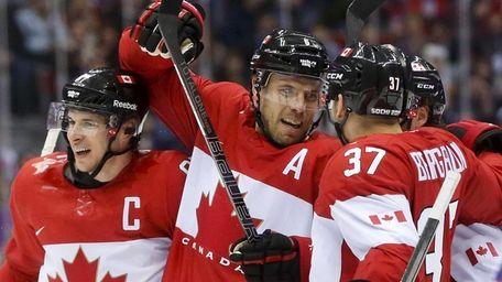 Canada defenseman Shea Weber, center, celebrates with forward