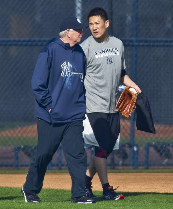 Yankees' Masahiro Tanaka walks with pitching coach Larry