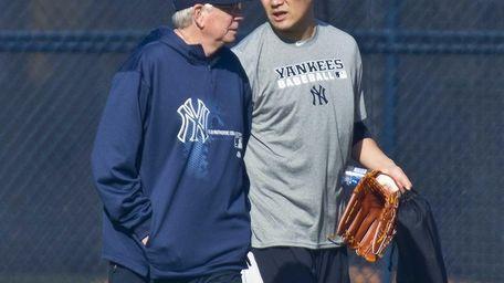 Yankees' Masahiro Tanaka walks with pitching coach Larry