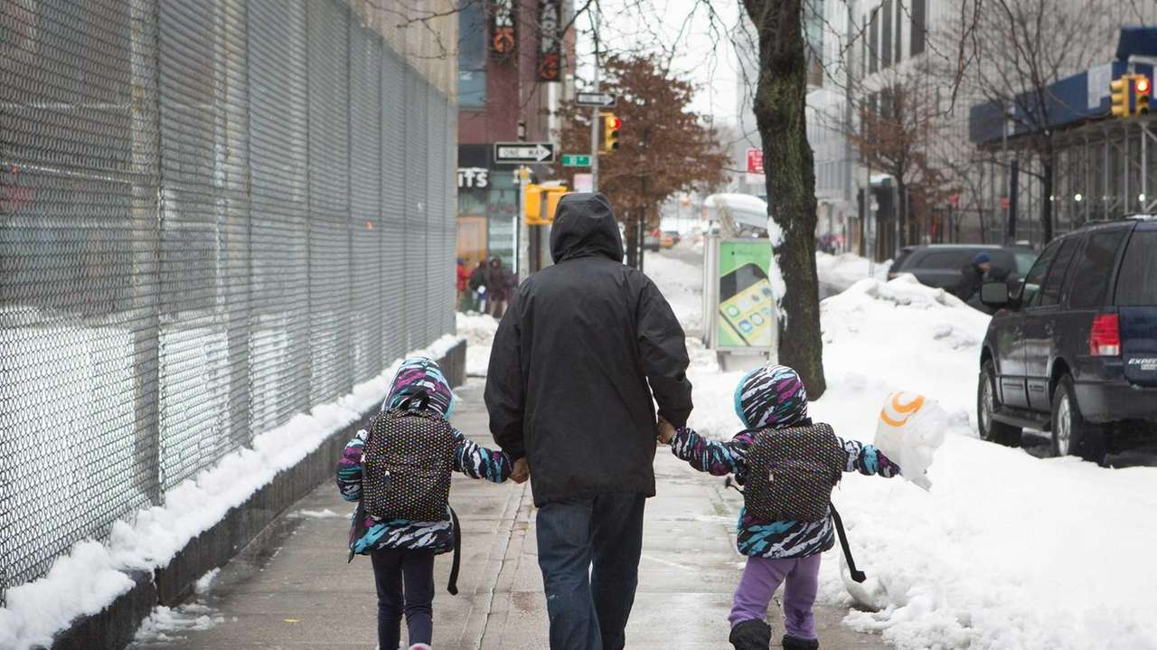 A man walking two girls home from P.S.