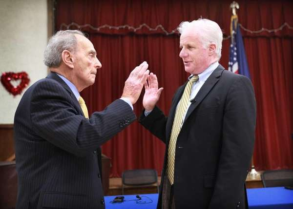 Patrick Vecchio, left, is sworn as Town of