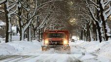A snowplow clears Pell Terrace in Garden City