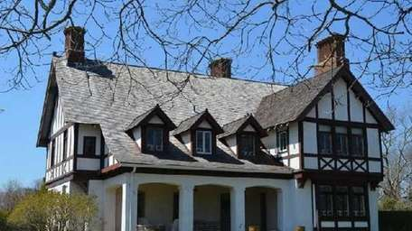 A waterfront Tudor estate on two acres in