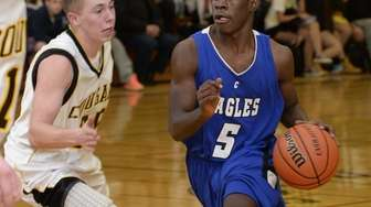 Copiague's Quandell Butler drives the ball against Commack