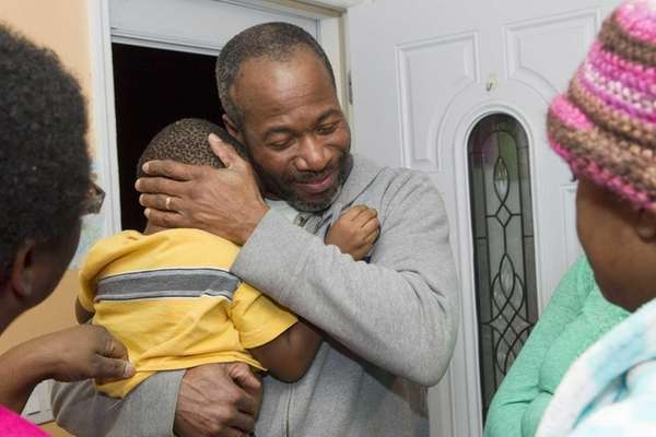 Pernell Mitchell gets a welcome home hug from