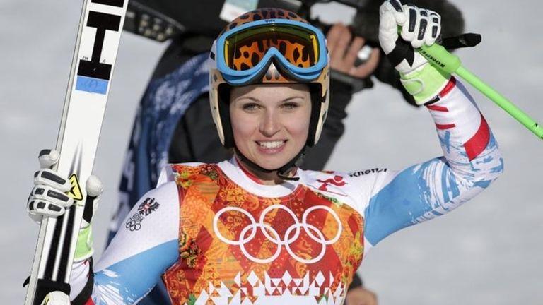 Austria's Anna Fenninger pauses in the finish area