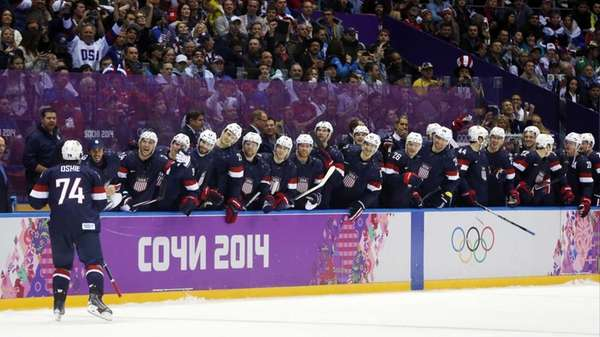 USA forward T.J. Oshie is greeted by teammates