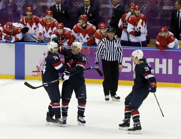 USA forward T.J. Oshie is congratulated by USA