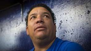 Mets pitcher Bartolo Colon talks to reporters after