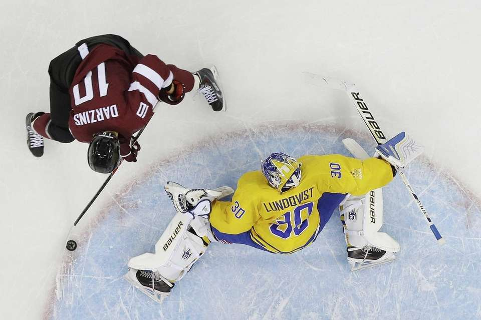 Latvia forward Lauris Darzins fires a goal shot