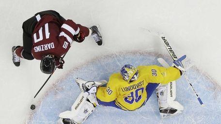 Latvia forward Lauris Darzins fires a goal shot
