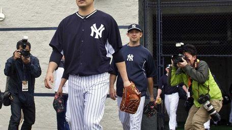 Members of the media take photographs as Yankees'
