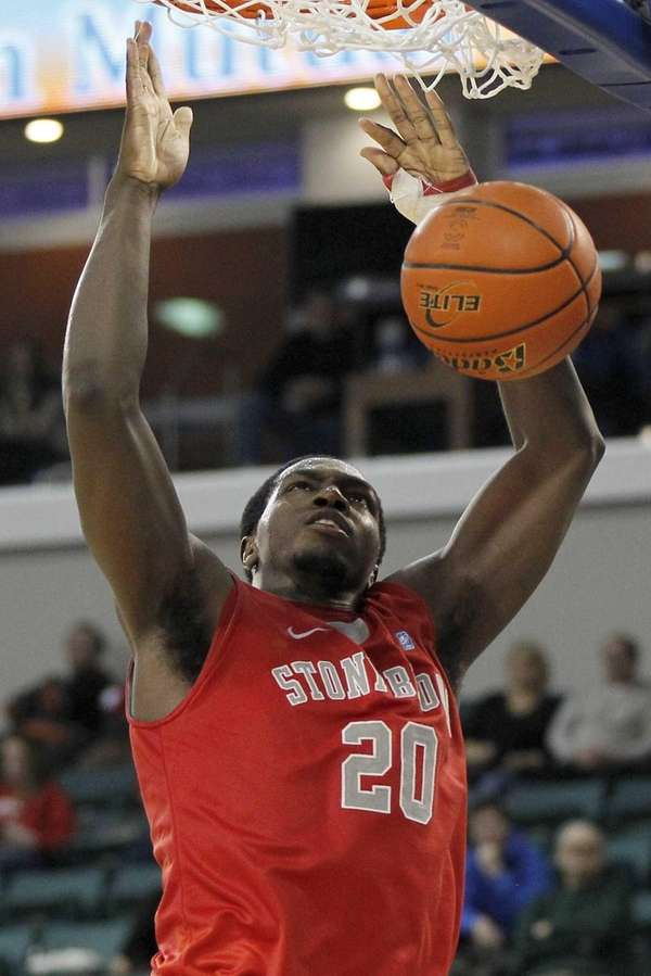 Stony Brook's Jameel Warney dunks the ball against