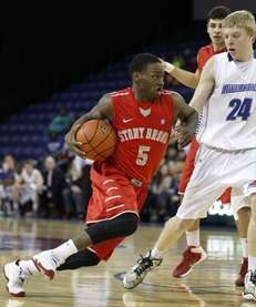 Stony Brook's Dave Coley drives against UMass-Lowell's Tyler