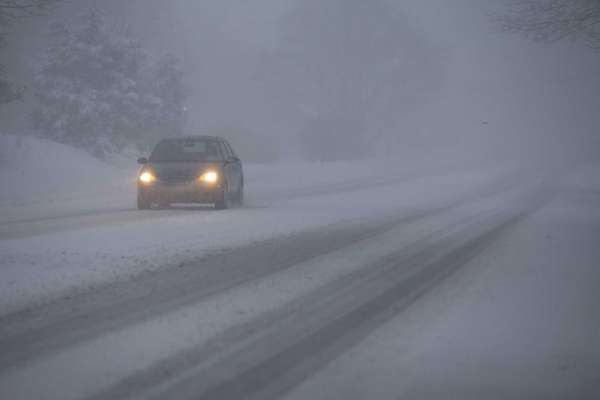 Low visibility as snow falls on Route 48
