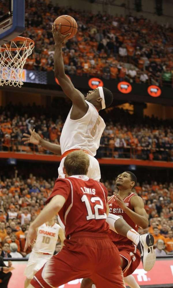 Syracuse's C.J. Fair, top, shoots what became the