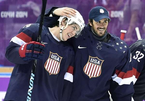 United States forward T.J. Oshie, left, is congratulated