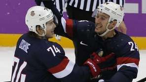 USA forward T.J. Oshie is congratulated by forward