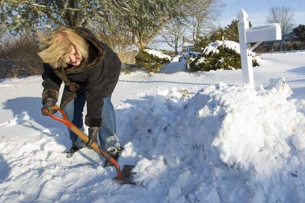 Elaine Syrkin of Cutchogue helps clear the snow