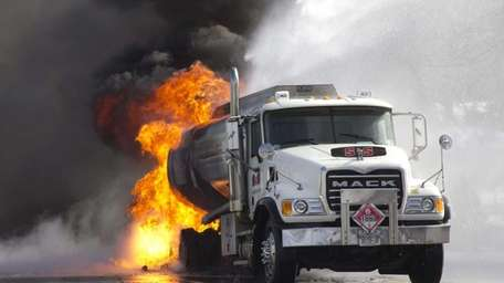 Firefighters battle a blaze in a heating-oil truck