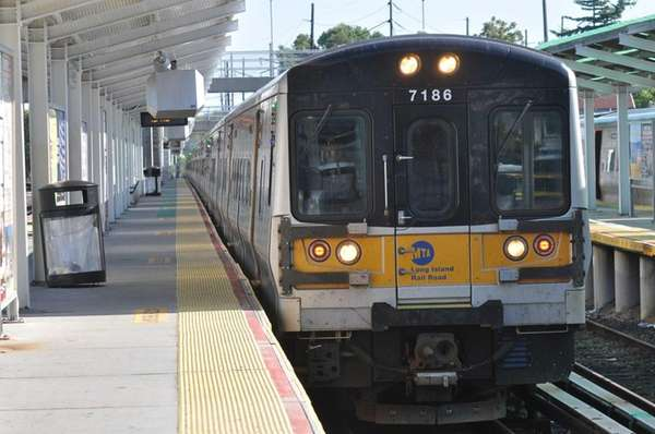 An off-peak train arrives at the Port Washington