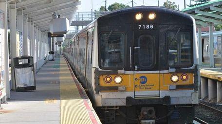 An off-peak train arrives at the Port Washington