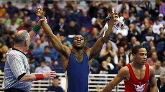 Jericho's Jaison White celebrates after defeating Freeport's Julius
