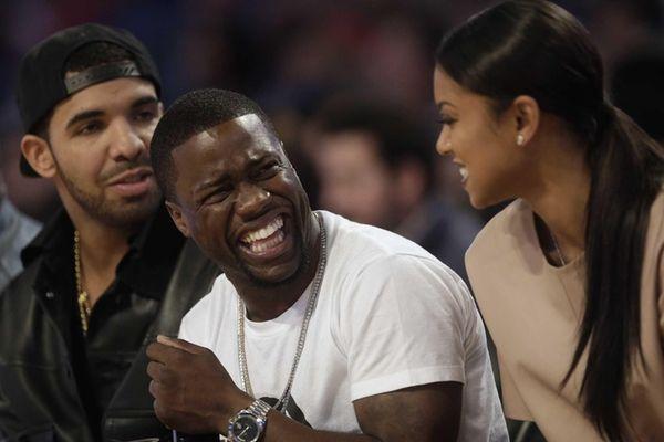 Actor Kevin Hart, center, laughs as Rapper Drake,