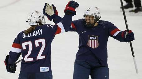 Kacey Bellamy of the United States (22) and