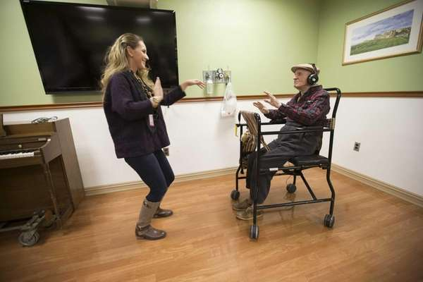 """Mary Kate Tusinski, therapeutic recreation specialist, """"dances"""" with"""