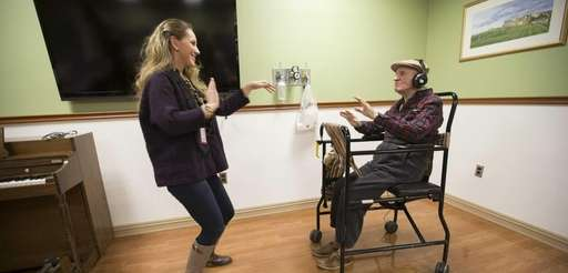 "Mary Kate Tusinski, therapeutic recreation specialist, ""dances"" with"