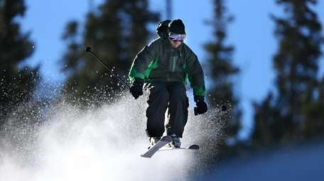 A skier enjoys opening day at Arapahoe Basin