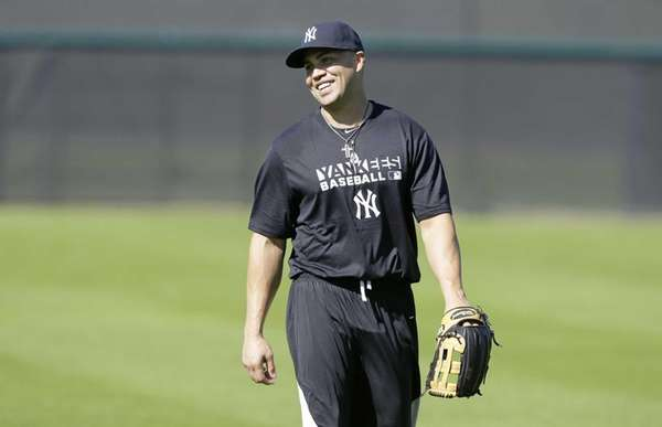 Yankees outfielder Carlos Beltran walks in the outfield