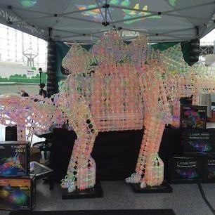 A dinosaur made of LED lights on display